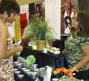 Janie Brodie owner of Brodie's Naturals LLC assisting a customer with product info.
